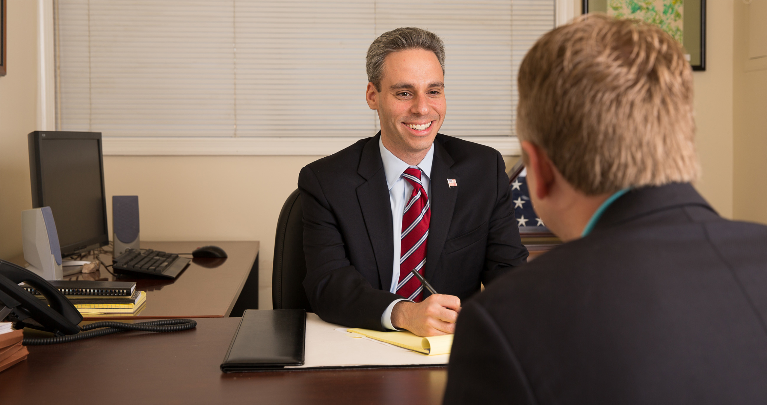 Photo of Attorney Scott Singer with client